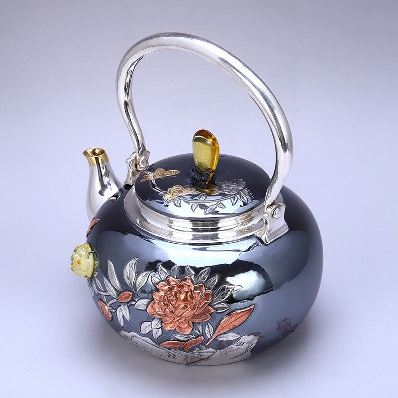 Sculptured and Embossed Nature Pattern Smooth Silver Teapot